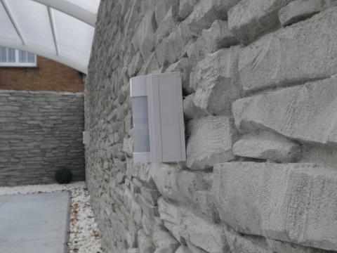 Keerwanden H 3 m met motief 'BRABANT' aan privéwoning